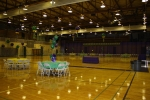 The Homecoming Dance ('Mardi Gras' theme) was being set up in the Purple Gym.